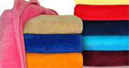 30x60 Terry Velour beach towels (assorted colors), 100% Cotton, 11.0 Lbs/Dz, 100 % Ring Spun cotton. 24 per case.